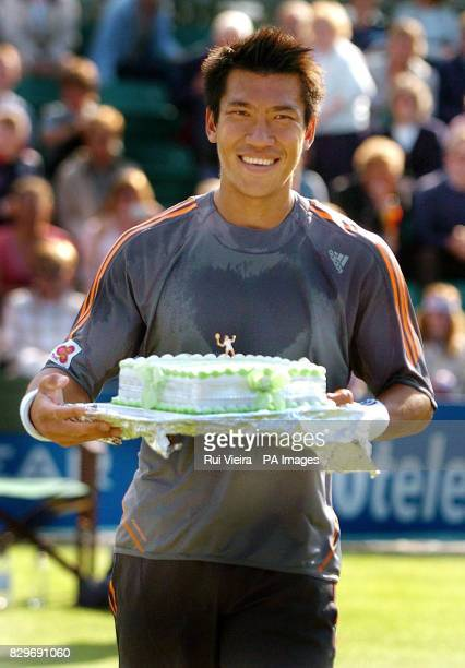 Defending champion Paradom Srichaphan of Thailand receives a birthday cake for his 26th birthday.