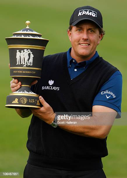 Defending champion Phil Mickelson of the USA poses with the new HSBC Champions trophy prior to the start of the HSBC Champions at the Sheshan Golf...