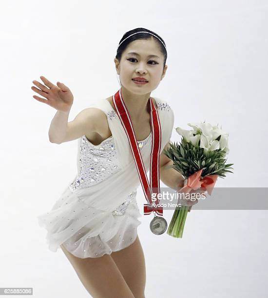 Defending champion Satoko Miyahara of Japan acknowledges the spectators after winning silver at the NHK Trophy figure skating tournament in the...
