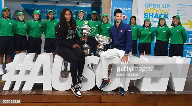 TOPSHOT Defending champions Serena Williams of the US and Novak Djokovic of Serbia pose with their trophies during a photocall ahead of the...