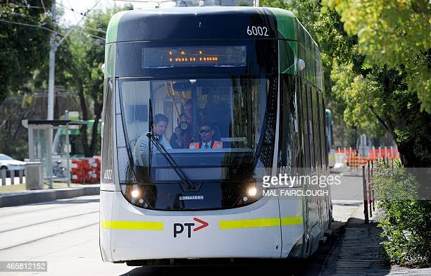 Defending Formula One Australian Grand Prix Nico Rosberg of Germany travels onboard an iconic Melbourne tram outside the famous Albert Park Grand...