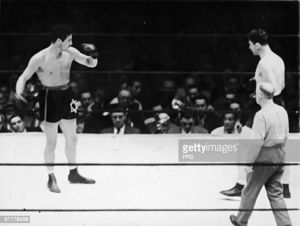 Defending heavyweight champion American boxer Max Baer shows off early during a title bout against American boxer James Braddock Long Island City New...