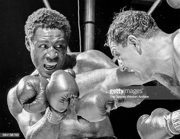 Defending heavyweight champion Rocky Marciano bulls into exchampion Ezzard Charles in the fifth round of bout Marciano won by eighthround knockout on...
