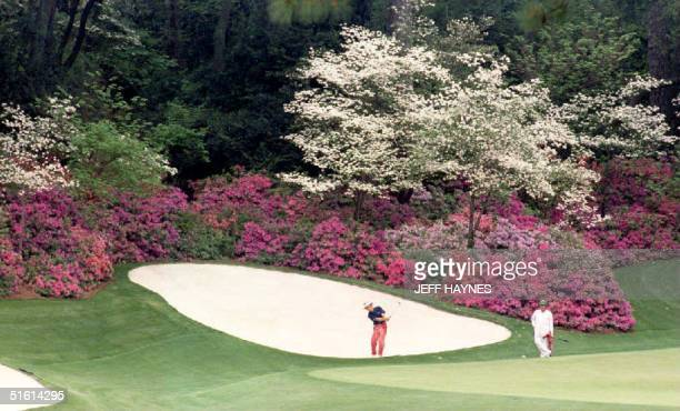 Defending Masters champion Bernhard Langer of Germany hits from the sand on the thirteenth hole 06 April 1994 in the famous Amen Corner of the...