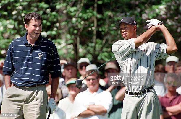 Defending Masters champion Tiger Woods of the US takes a practice swing as he waits in the tee box on the second hole with 1997 US Amateur champion...