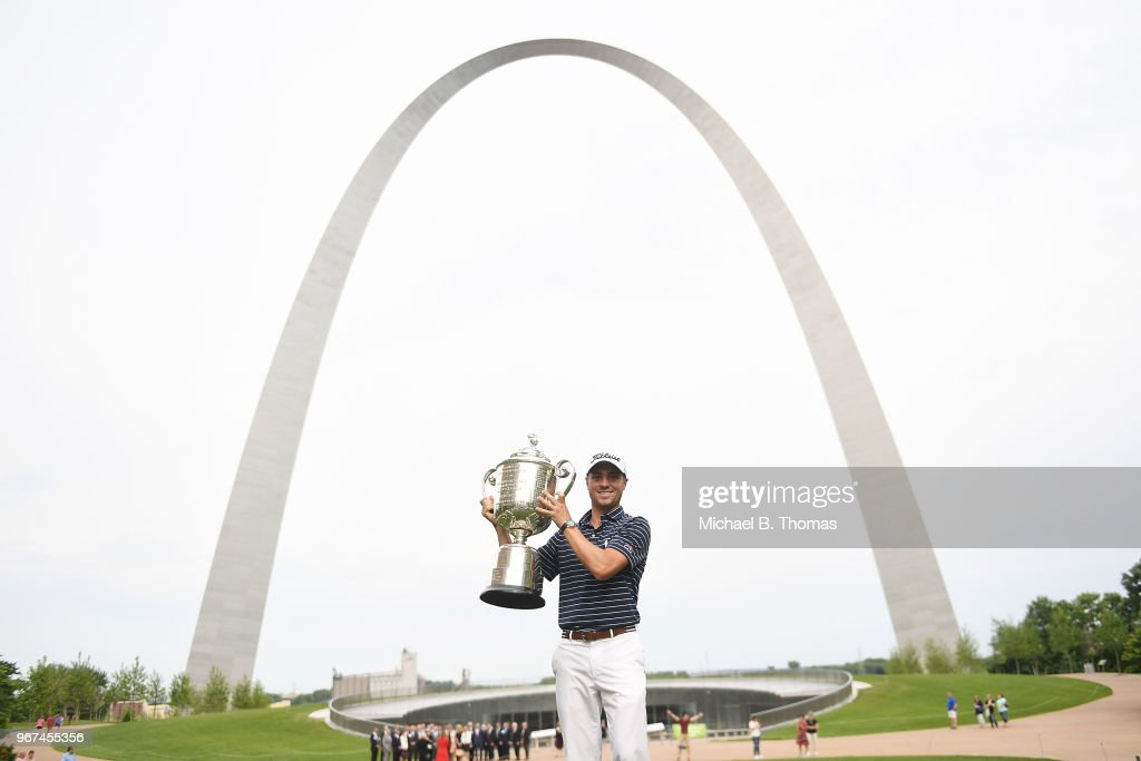 Defending PGA Champion, Justin Thomas hoists the Wanamaker PGA Championship Trophy during the 2018 PGA Championship Media Day visit to the Gateway Arch on June 4, 2018 in St Louis, Missouri.