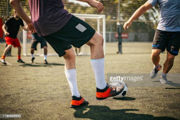 defending the ball - shooting at goal stock pictures, royalty-free photos & images