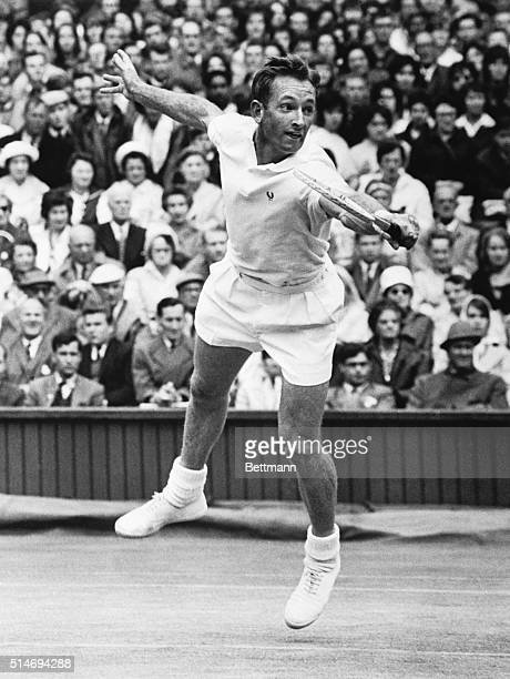 Defending Wimbledon champion Rod Laver returns the ball in a singles semifinal match at the 1962 Wimbledon