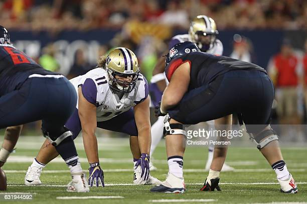 Defenisve line Elijah Qualls of the Washington Huskies in action during the college football game against Arizona Wildcats at Arizona Stadium on...
