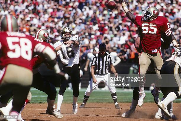 Defenive end Lawrence Pillers of the San Francisco 49ers attempts to bat down a pass thrown by quarterback Ken Stabler of the New Orleans Saints as...