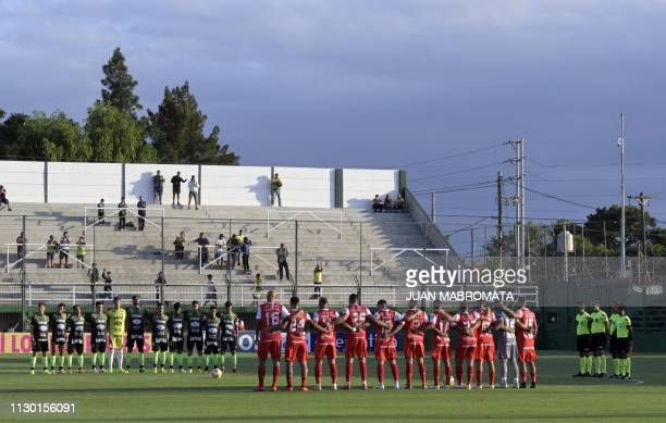 Defensa y Justicia and Argentinos Juniors footballers pay homage to late footballer Emiliano Sala during the Argentine Superliga football match at...
