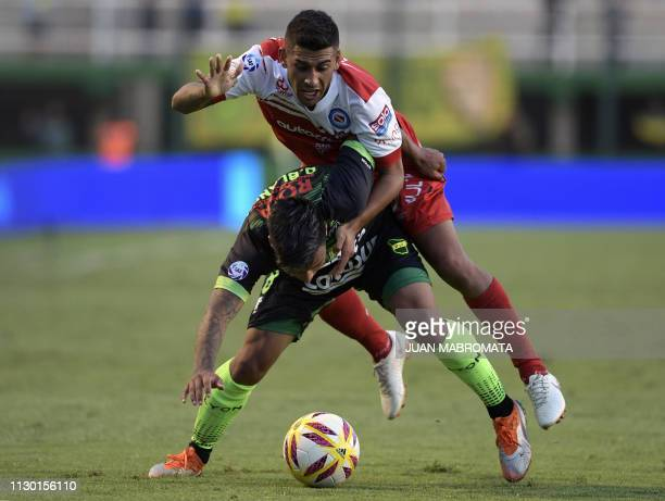 Defensa y Justicia's midfielder Domingo Blanco and Argentinos Juniors' defender Franco Moyano vie for the ball during Argentina's Superliga football...