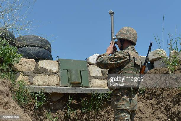 Defense Army soldier carries a normal duties at the line of contact post, near Martuni, as the situation stays relatively calm in the line of contact...