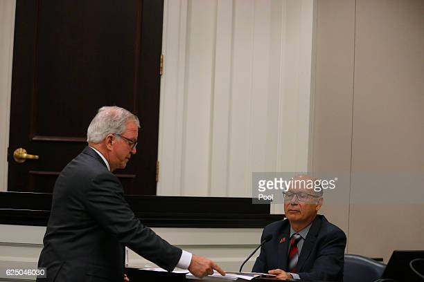 Defense attorney Andy Savage hands a document to William Schneck during the trial of former North Charleston police officer Michael Slager at the...