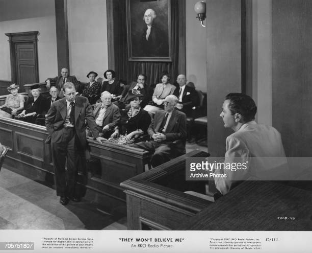 Defense Attorney Cahill crossexamines Larry Ballentine during his trial for murder in a publicity still for Irving Pichel's film noir 'They Won't...