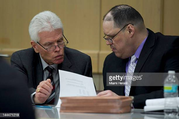Defense attorney Christopher Pole, left, talks to his client Randy Tundidor Sr. In the court room of Cynthia G. Imperato in Broward County Circuit...