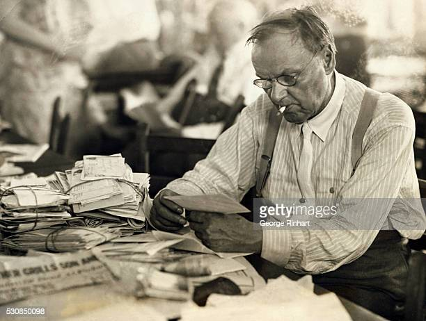 Defense attorney Clarence Darrow reading his mail during the Scopes trial in 1925