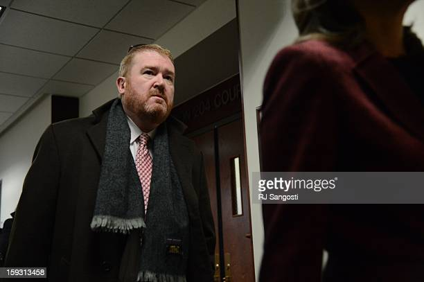 Defense attorney Daniel King leaves the courtroom of the Arapahoe County Courthouse Friday January 11 2013 The arraignment for Aurora theater...