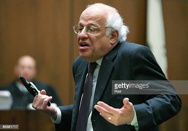 Defense attorney Doron Weinberg talks about forensic evidence on the gun during closing arguments in the retrial murder case of music producer Phil...