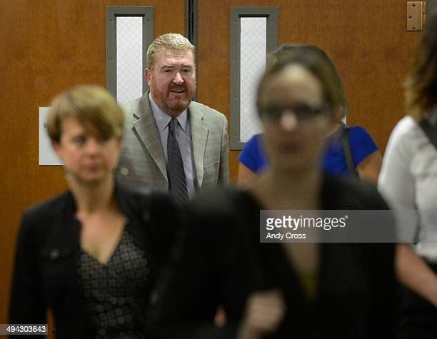 Defense attorney for James Holmes Daniel King center arrives at the Arapahoe County Justice Center for a motion hearing involving particular...
