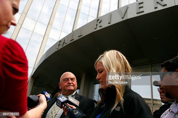Defense attorney John Connors second from left who is representing Carlos Ortiz talks to reporters outside of the courthouse following Ortiz's...