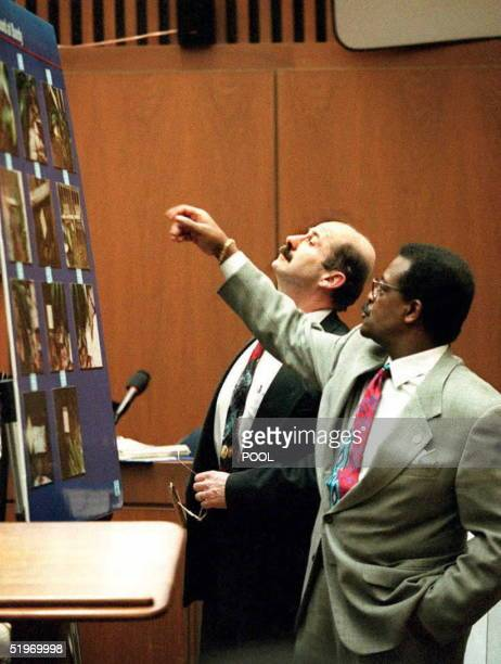 Defense attorney Johnnie Cochran Jr points to a chart showing pictures of the blood stained back gate of Nicole Brown Simpson's condominium 23...