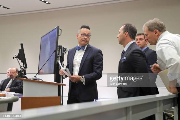 Defense attorney Joseph DiRuzzo center looks back at defense attorney David Sobel following a first appearance hearing for their client Scot Peterson...