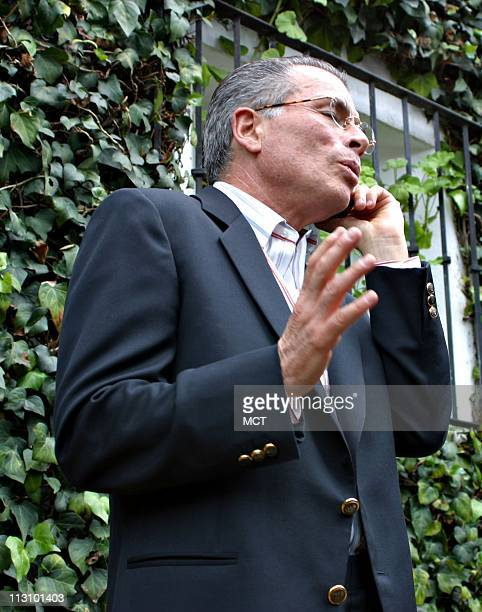 MEXICO CITY MEXICO Defense attorney Juan Velasquez speaks on celphone as he arrives at the residence of former President Luis Echeverria in Mexico...