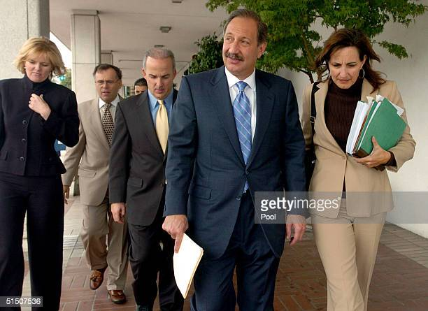Defense attorney Mark Geragos and members of his team including Pat Harris leave the San Mateo County Courthouse October 19 2004 in Redwood City...