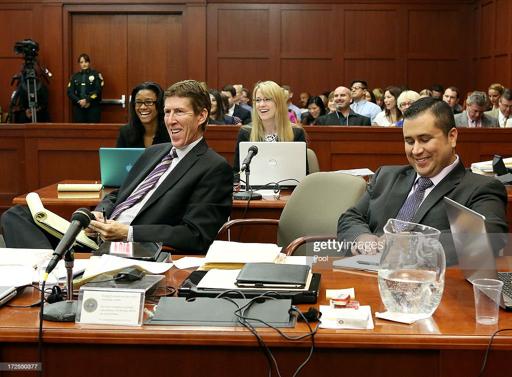 Defense attorney Mark O'Mara, left, and George Zimmerman smile at a witnesses answer during Zimmerman's trial in Seminole circuit court, July 3, 2013 in Sanford, Florida. Zimmerman is charged with second-degree murder for the February 2012 shooting death of 17-year-old Trayvon Martin.