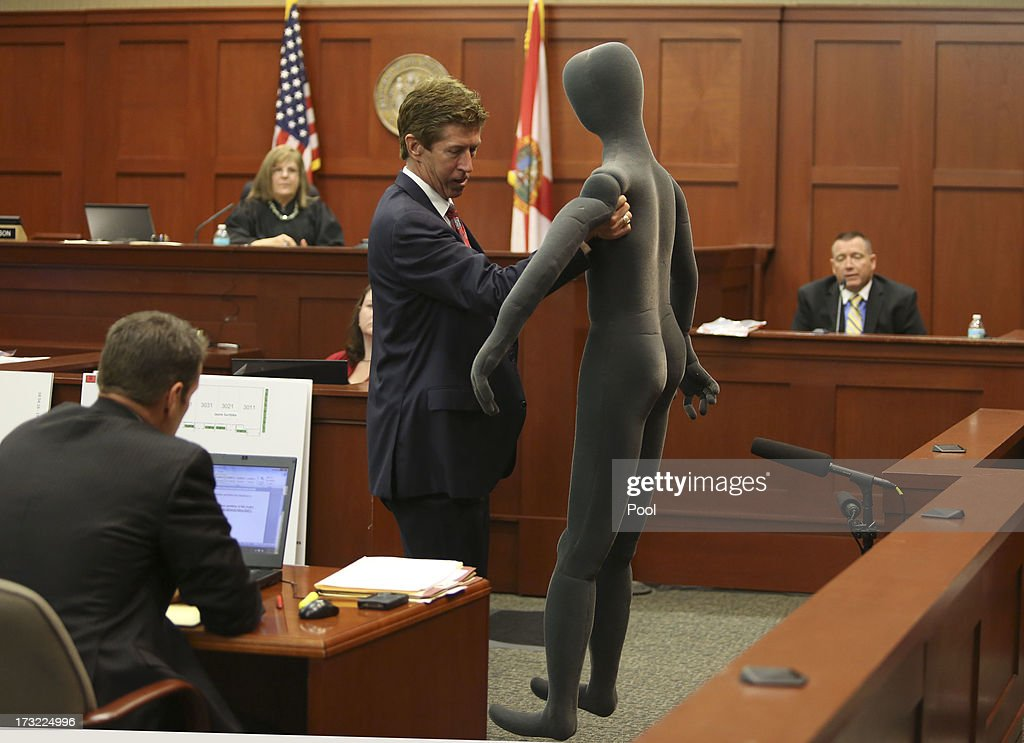 Defense attorney Mark O'Mara (2nd R) uses a foam dummy to describe the altercation between George Zimmerman and Trayvon Martin to defense witness and law enforcement expert Dennis Root (R) during Zimmerman's murder trial in Semimole circuit court July 10, 2013 in Sanford, Florida. Zimmerman has been charged with second-degree murder for the 2012 shooting death of Trayvon Martin.