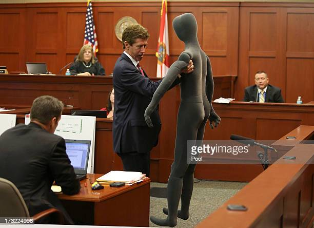 Defense attorney Mark O'Mara uses a foam dummy to describe the altercation between George Zimmerman and Trayvon Martin to defense witness and law...