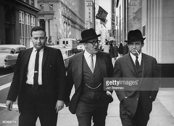Defense attorney Melvin M Belli with associates Vasilios B Choulos and Seymour Ellison