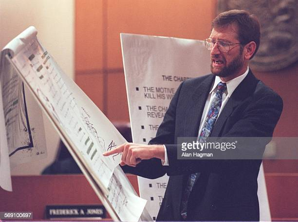 """Defense attorney Neil Quinn reads from a """"Love Guarantee"""" – part of a love letter written by Diana Haun expressing her hopes for a future marriage..."""