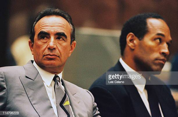 Defense attorney Robert Shapiro sits next to OJ Simpson during a preliminary hearing following the murders of Simpson's exwife Nicole Brown Simpson...