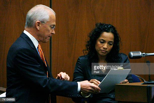 Defense attorney Roger Rosen shows witness Sophia Holguin a waitress at the House of Blues on the night Lana Clarkson was murdered a transcript of...