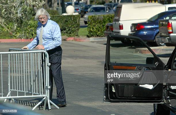 Defense attorney Thomas Mesereau Jr moves a barrier to drive his car from a secured parking area following a pretrial hearing in the Michael Jackson...