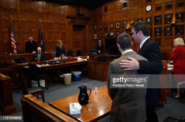 Defense attorney Verne Paradie puts his arm around John D Williams moments after a jury found him guilty in the murder of Cpl Eugene Cole Tuesday...
