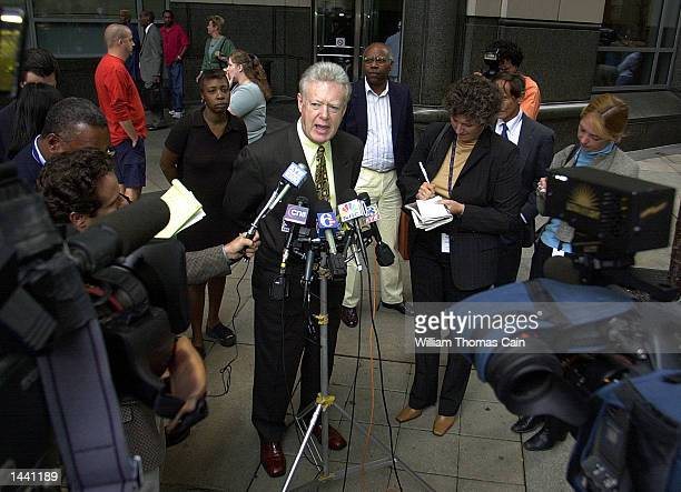 Defense attorney William Cannon speaks to the media outside the Criminal Justice Center October 1 2002 in Philadelphia Pennsylvania Cannon is on the...