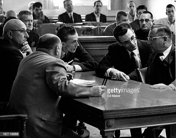 NOV 27 1962 NOV 28 1962 Defense Attorneys And Defendants Confer After Guilty Verdict On Manslaughter Charge Clockwise from lower left ore Sol Cohen...