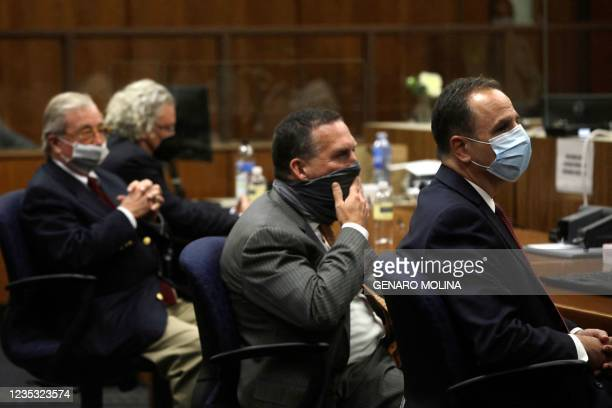Defense attorney's David Chesnoff and Dick Deguerin and prosecuting attorney's, Deputy District Attorney John Lewin and Habib A. Balian listen to the...