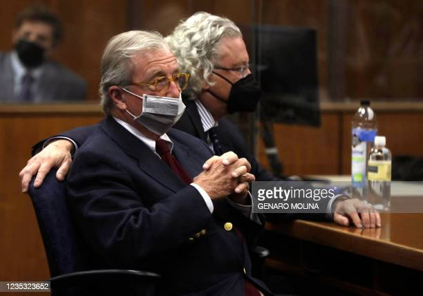 Defense attorney's Dick Deguerin and David Chesnoff listen to the verdict being read by Los Angeles Superior Court Judge Mark E. Windham as New York...