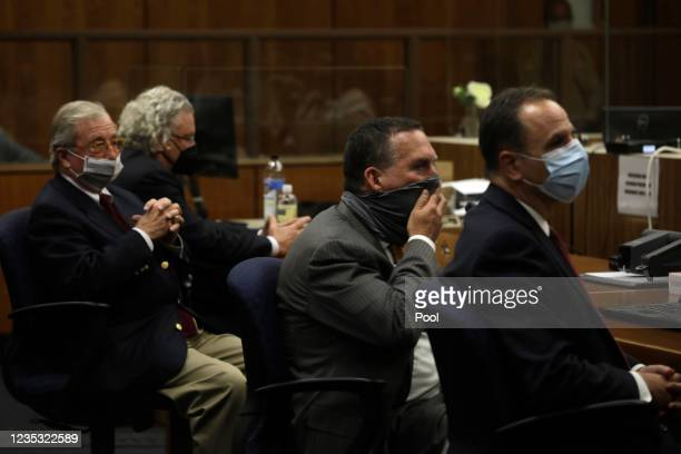 Defense attorneys Dick Deguerin, David Chesnoff, Deputy District Attorney John Lewin and Habib A. Balian listen as the verdict is read by Los Angeles...