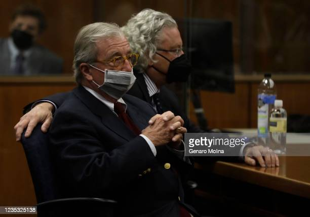 Defense attorneys Dick Deguerin, left, and David Chesnoff listen to the verdict being read by Los Angeles Superior Court Judge Mark E. Windham as New...