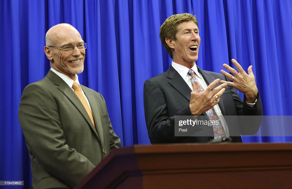 Defense attorneys Don West (L) and Mark O'Mara address the media after a jury found George Zimmerman not guilty in Seminole circuit court July 13, 2013 in Sanford, Florida. Zimmerman was acquitted of second-degree murder in the 2012 shooting death of Trayvon Martin.