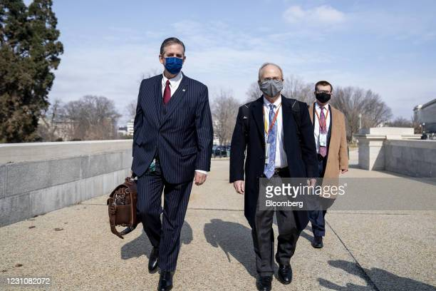 Defense attorneys for Donald Trump, Bruce Castor, left, and David Schoen wear protective masks while arriving to the U.S. Capitol in Washington,...