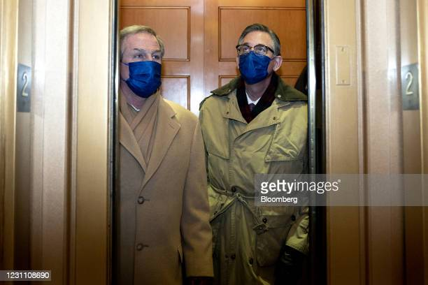 Defense attorneys for Donald Trump, Michael van der Veen, left, and Bruce Castor wear protective masks while departing the U.S. Capitol in...