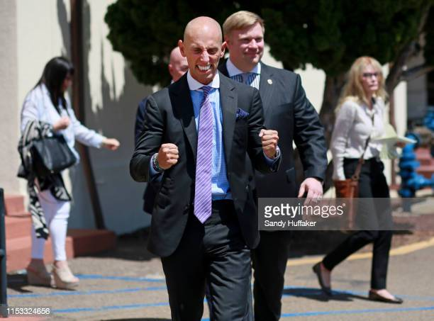Defense attorneys Marc Mukasey and Tim Parlatore react outside military court after Navy Special Operations Chief Edward Gallagher was acquitted of...