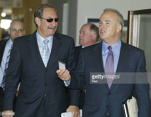 Defense attorneys Mark Geragos and Pat Harris leave the San Mateo County Courthouse for a lunch break in the Scott Peterson trial August 23, 2004 in...