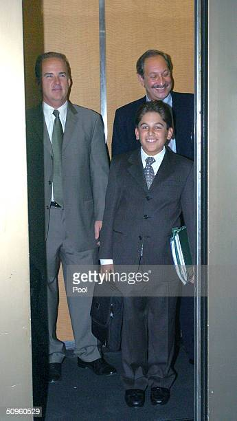 Defense attorneys Patrick Harris and Mark Geregos chuckle as they leave the San Mateo County Courthouse along with Geregos' nephew Mike Geregos after...